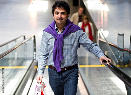 man on a escalator in a shopping center