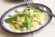 Ravioli with snap peas and almonds