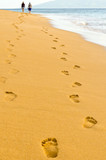 Human footprints leading away from the viewer