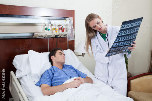 Doctor showing report to the patient