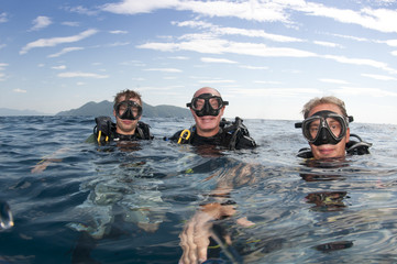 scuba divers on surface