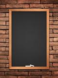 Fototapety blackboard on wall background.