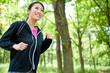 beautiful asian woman jogging in the park