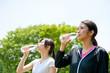 beautiful asian women drinking a bottle of water