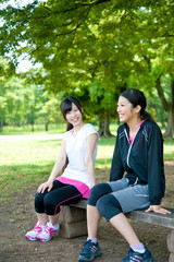 beautiful asian women relaxing in the park