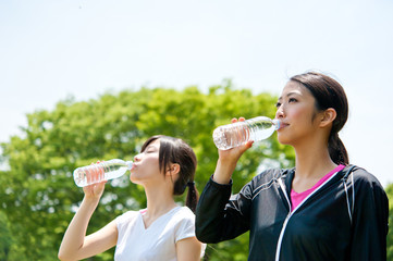 beautiful asian women drinking a bottle of water