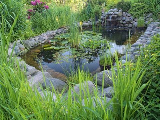 Ornamental pond with waterfall in garden