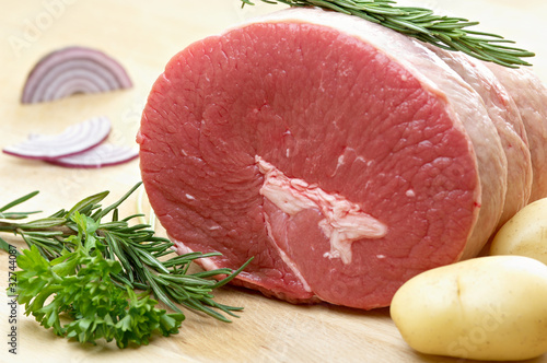 raw food, roast beef, onion, parsley, potatoes and rosemary