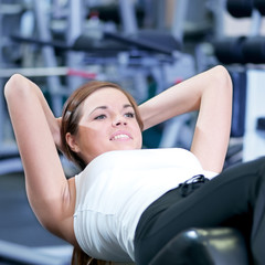 Beautiful sport woman doing press exercise