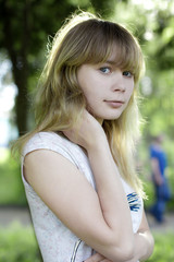 Portrait of young shying girl in the park