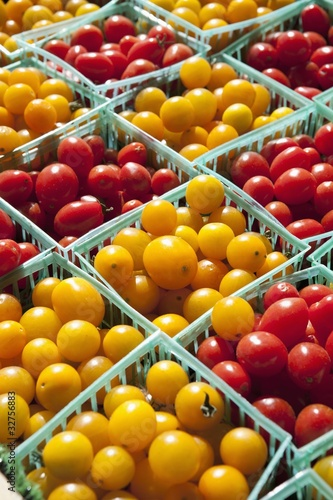yellow and red cherry tomatoes in small baskets