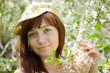 girl in spring blossoming garden