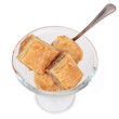 Biscuits in a glass bowl on a white background