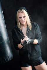 Blond boxing woman in black prepare training