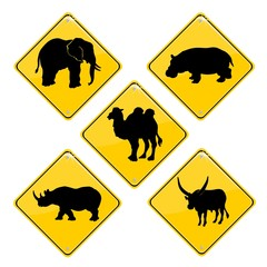 Yellow traffic signs with African animals