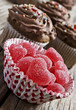 Red heart jelly sweets and chocolate cupcakes
