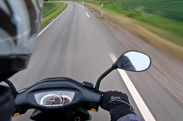 Motorcycle traveling Man