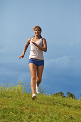 running girl on green grass