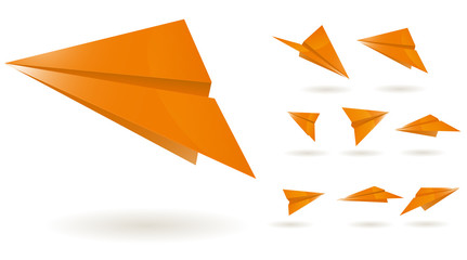 orange paper planes isolated on white background