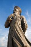 Fototapete Fabric - Pionier - Statue