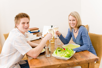 Happy couple enjoy wine eat fit salad