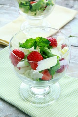 summer salad with strawberries, cheese and lettuce