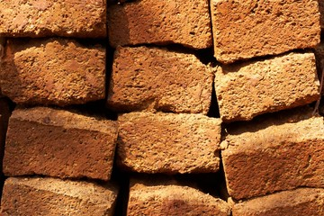 Pattern of old orange rough bricks