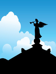 Silhouette of an angel on a roof