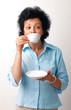 Elder Woman Drinking Coffee.