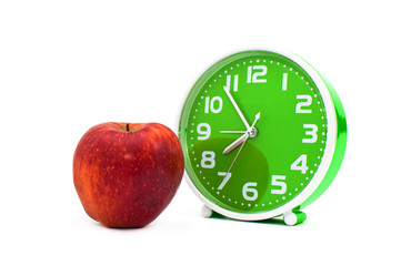 Clock and an apple
