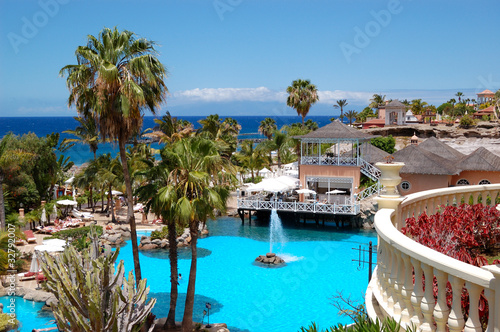 Swimming pool, open-air restaurant and beach of luxury hotel, Te