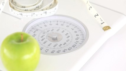 Weighing scales and apple turning on themselves