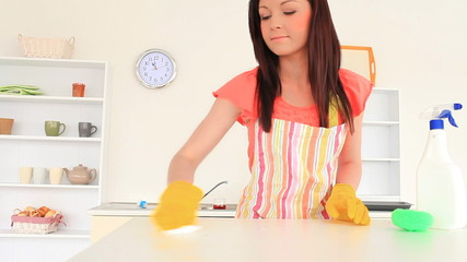 Attractive woman cleaning the kitchen