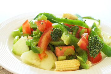 Fresh salad with cucumber, tomato and peppers
