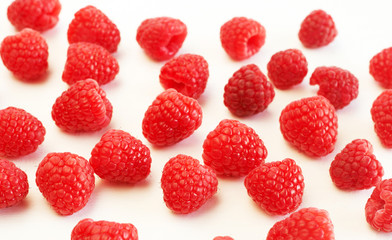 Fresh raspberries on white background