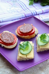 canape sandwiches with cheese and salami