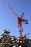 Red crane on buidling site