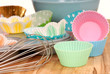Variety of cupcake liners with wire wisk