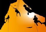 Climbing the rock at sunset