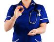 nurse holding pill