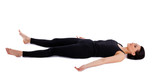 young woman relax after yoga - savasana pose