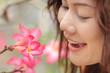 asian woman looking flower
