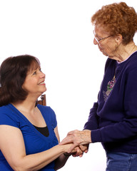 Two women greeting one another