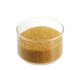 Golden demerara  sugar in glass bowl isolated on white
