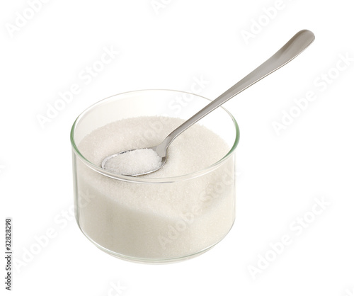 White sugar in glass bowl with teaspoon
