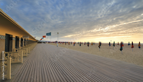 Fotobehang Zonsondergang op het Strand deauville