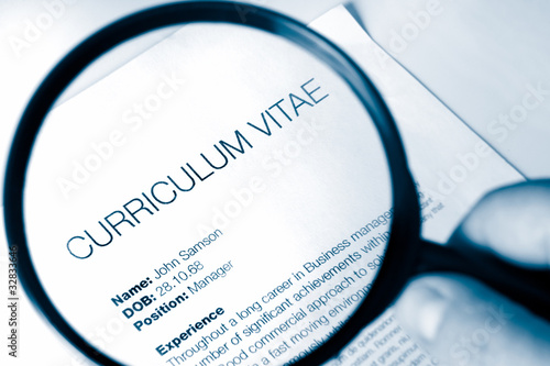 magnifying glass and cv