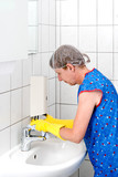 Cleaning Woman at Soap Dispenser