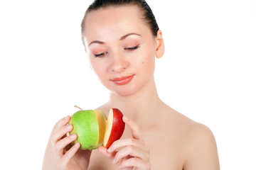 Combination of green apple and red apple slice in hands