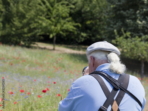 canvas print picture Photographer shooting poppies and blueberries